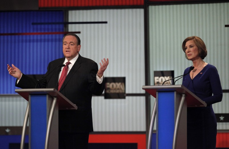 Former Arkansas Governor Huckabee speaks as former HP CEO Fiorina listens during a forum for lower polling candidates at the Fox Business Network Republican presidential candidates debate in North Charleston (Reuters Pictures)