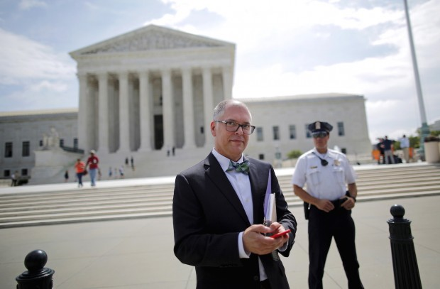 Jim Obergefell walks out of the U.S. Supreme Court in Washington June 18, 2015. A ruling on Obergefell v. Hodges, and whether the U.S. Constitution's guarantees of due process and equal protection under the law covers a right to same-sex marriage; and, if not, whether states that ban same-sex marriages must recognize those performed elsewhere, is expected from the Court by month's end. REUTERS/Carlos Barria - RTX1H67D