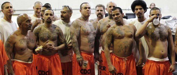 Inmates stand in a gymnasium where they are housed due to overcrowding at the California Institution for Men state prison in Chino, California, in this June 3, 2011 file photo. REUTERS/Lucy Nicholson/Files