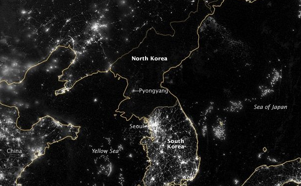 North Korea's barren electrical grid at night compared to South Korea's grid, which teems with lights.