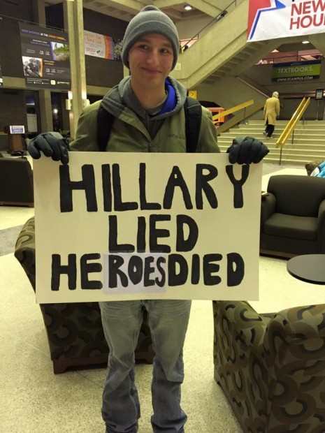 Anti-Hillary sign outside the DNC Debate in Milwaukee on Feb. 11, 2016 (Philip DeVoe)