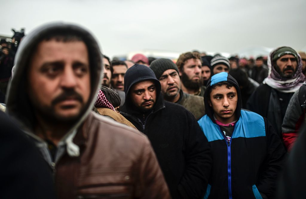 Refugees wait for tents as Syrians fleeing the northern embattled city of Aleppo wait on February 6, 2016 in Bab al-Salama, near the city of Azaz, northern Syria (Getty Images)