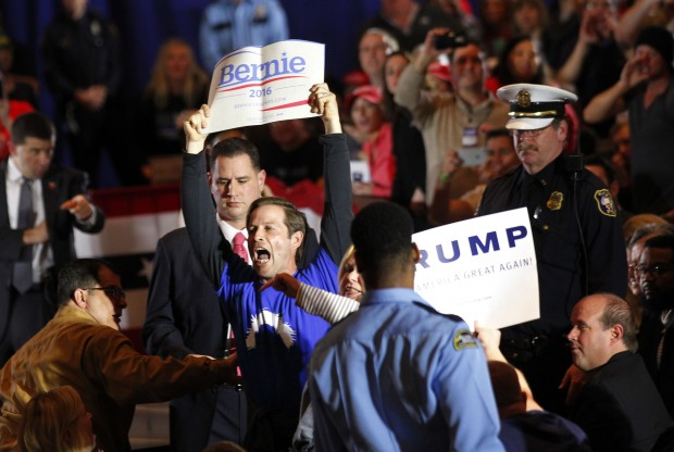 CINCINNATI, OH- MARCH 13: A Bernie Sanders' supporter is taken out by police during Republican Presidential candidate Donald Trump's campaign rally at the Savannah Center March 13, 2016, in Cincinnati, Ohio. Trump continue to campaign before Ohio March 15th primary day. (Photo by John Sommers II/Getty Images)