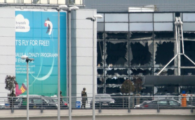 Crews and passengers being evacuated Zaventem Bruxelles International Airport after terrorist attcks. In the background glass front of departure hall appears to be blown out. (Photo: Sylvain Lefevre/Getty Images)