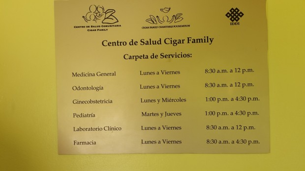 Sign in front of Community Health Center of Cigar Family Foundation School in Bonao, Dominican Republic