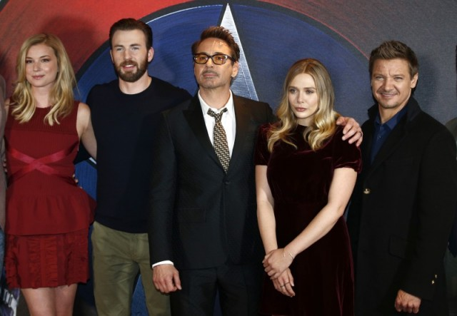 "Actors (L-R) Emily VanCamp, Chris Evans, Robert Downey Jr, Elizabeth Olsen and Jeremy Renner, pose for photographers at a media event ahead of the release of, ""Captain America: Civil War"", in London, Britain, April 25, 2016. REUTERS/Peter Nicholls"