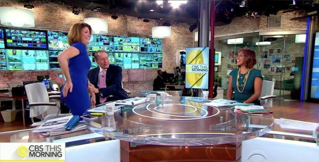 Action shot of Charlie Rose showing how to spank Norah O'Donnell, Screen Shot CBS This Morning