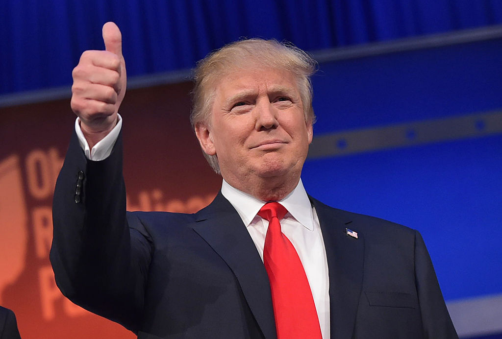 Real estate tycoon Donald Trump flashes the thumbs-up as he arrives on stage for the start of the prime time Republican presidential debate on August 6, 2015 at the Quicken Loans Arena in Cleveland, Ohio. AFP PHOTO/MANDEL NGAN / AFP / MANDEL NGAN (Photo credit should read MANDEL NGAN/AFP/Getty Images)