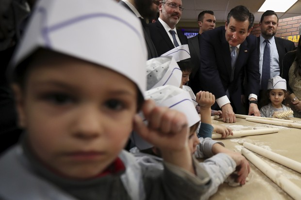Republican presidential candidate Ted Cruz speaks to children after making matzah at a campaign event in the Brooklyn borough of New York April 7, 2016