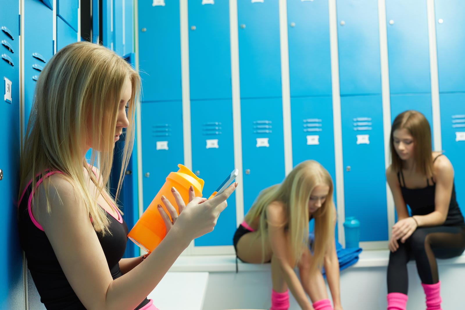 Biological females sit in the girls' locker room (Shutterstock)