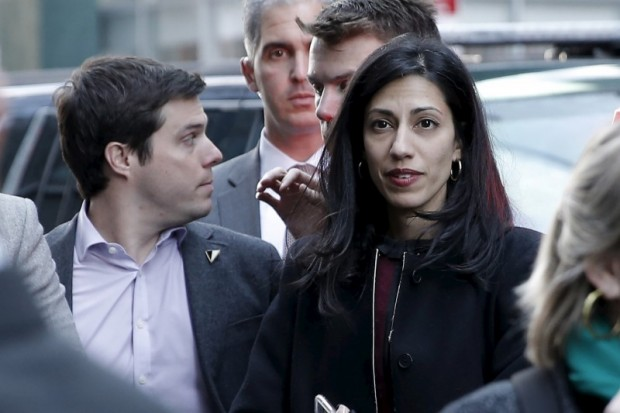 Huma Abedin, aide to U.S. Democratic presidential candidate Hillary Clinton, looks on as Clinton makes a campaign stop to greet picketing Verizon workers who are out on strike in the Manhattan borough of New York