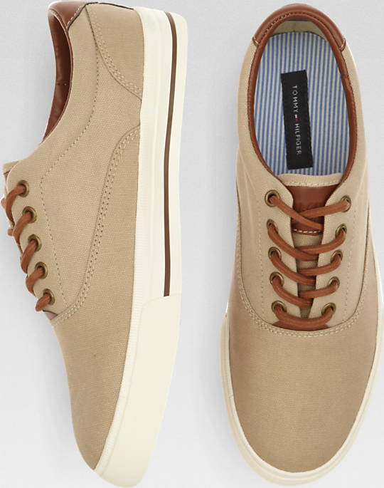 These Tommy Hilfiger Paulie Canvas sneakers come in tan, black and navy (Photo via Men's Wearhouse)