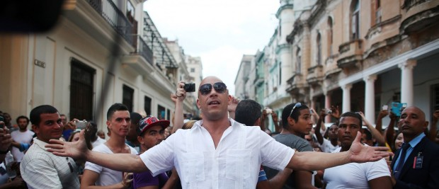 Actor Vin Diesel poses before a fashion show by German designer Karl Lagerfeld as part of his latest inter-seasonal Cruise collection for fashion house Chanel at the Paseo del Prado street in Havana, Cuba