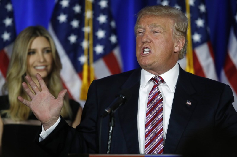 Republican U.S. presidential candidate Donald Trump speaks as his daughter Ivanka (L) looks on at a campaign event on the day that several states held presidential primary elections, including California, at the Trump National Golf Club (REUTERS PICTURES)