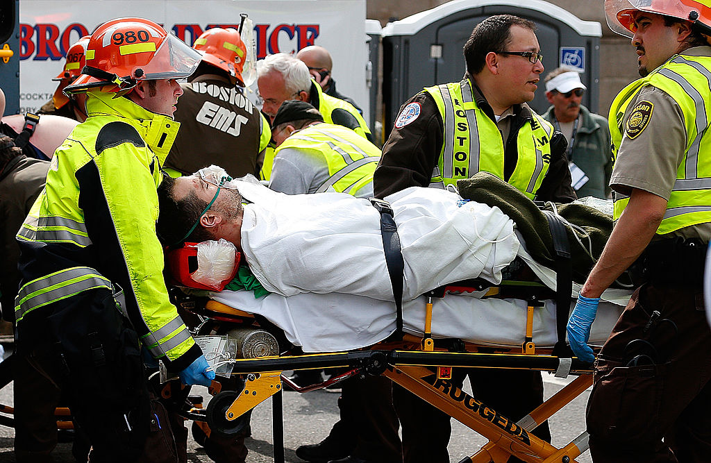 A man is loaded into an ambulance after he was injured by one of two bombs exploded during the 117th Boston Marathon near Copley Square on April 15, 2013 in Boston, Massachusetts. Two people are confirmed dead and at least 23 injured after two explosions went off near the finish line to the marathon. (Getty Images)