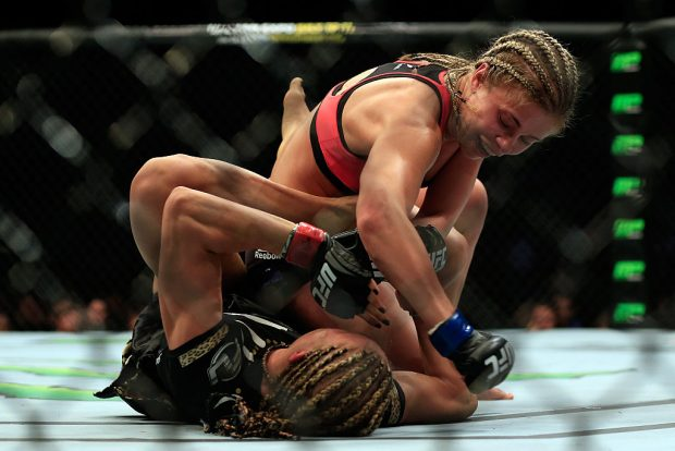 NEWARK, NJ - APRIL 18: Felice Herrig (black top) and Paige VanZant (pink top) fight in their women's strawweight bout during the UFC Fight Night event at Prudential Center on April 18, 2015 in Newark, New Jersey. (Photo by Alex Trautwig/Getty Images)