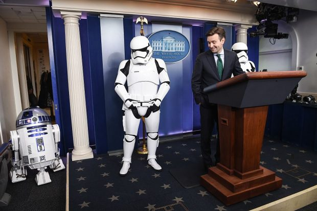 Josh Earnest speaks to the press in the briefing room at the White House with R2D2 and Storm Troopers. (Getty Images)