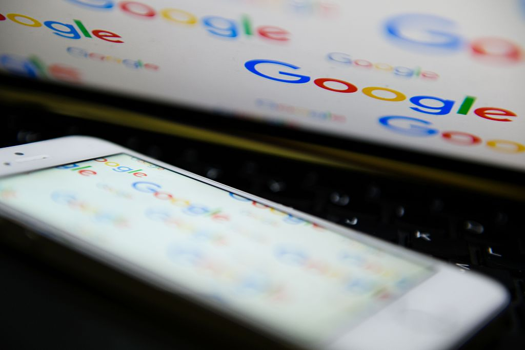 The logo for US technology company and search engine Google is displayed on screens (Getty Images)