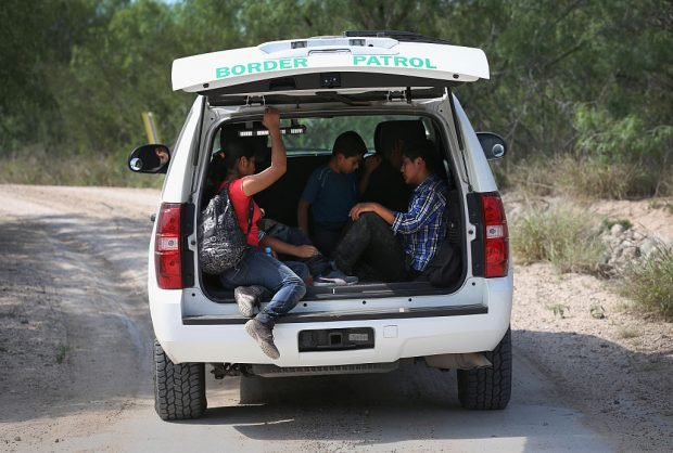 ROMA, TX - APRIL 14: Central American children are transported for processing by the U.S. Border Patrol after they crossed the Rio Grande from Mexico into the United States to seek asylum on April 14, 2016 in Roma, Texas. Border security and immigration, both legal and otherwise, continue to be contentious national issues in the 2016 Presidential campaign. (Photo by John Moore/Getty Images)