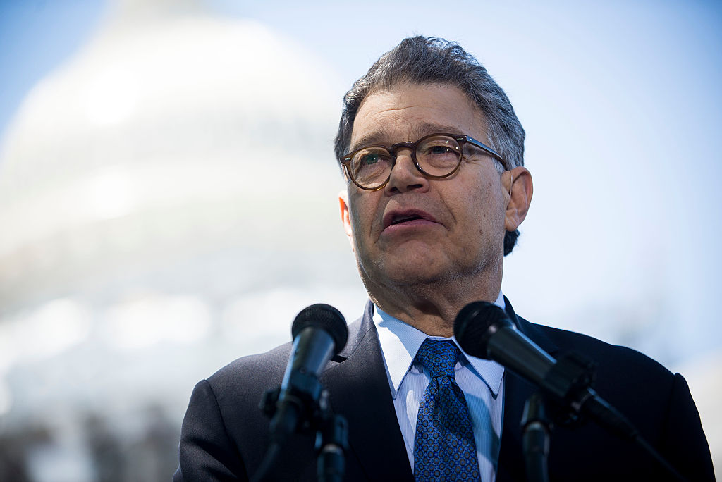 Al Franken speaks to reporters at a news conference dubbed #WeThePeople outside the Capitol (Getty Images)