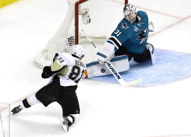 SAN JOSE, CA - JUNE 12: Phil Kessel #81 of the Pittsburgh Penguins takes a shot on Martin Jones #31 of the San Jose Sharks in the third period in Game Six of the 2016 NHL Stanley Cup Final at SAP Center on June 12, 2016 in San Jose, California. (Photo by Ezra Shaw/Getty Images)