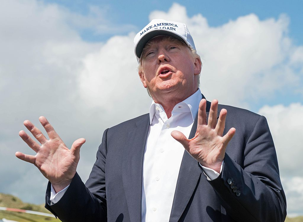 Donald Trump speaks to members of the media during a tour of his International Golf Links course north of Aberdeen (Getty Images)