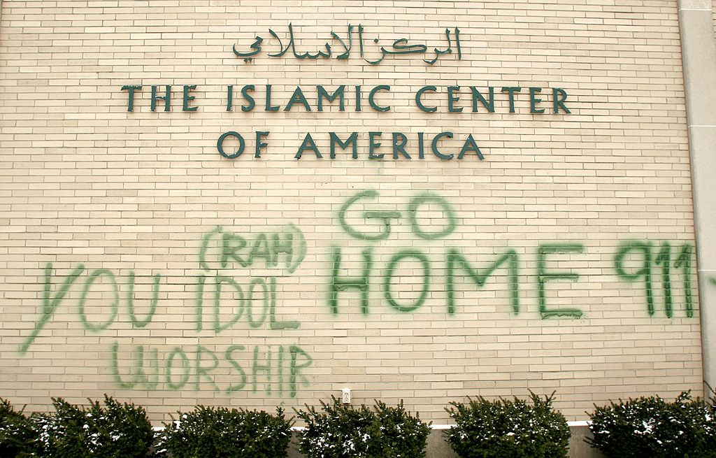 Anti-Muslim graffiti defaces a shi'ite mosque at the Islamic Center of America in Dearborn, Michigan. (Getty Images)