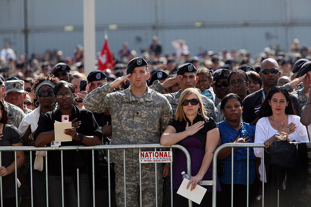 People attend the memorial service that U.S. President Barack Obama and first lady Michelle Obama are attending for the thirteen victims of the shooting rampage by U.S. Army Major Nidal Malik Hasan on November 10, 2009 in Fort Hood, Texas. (Getty Images)