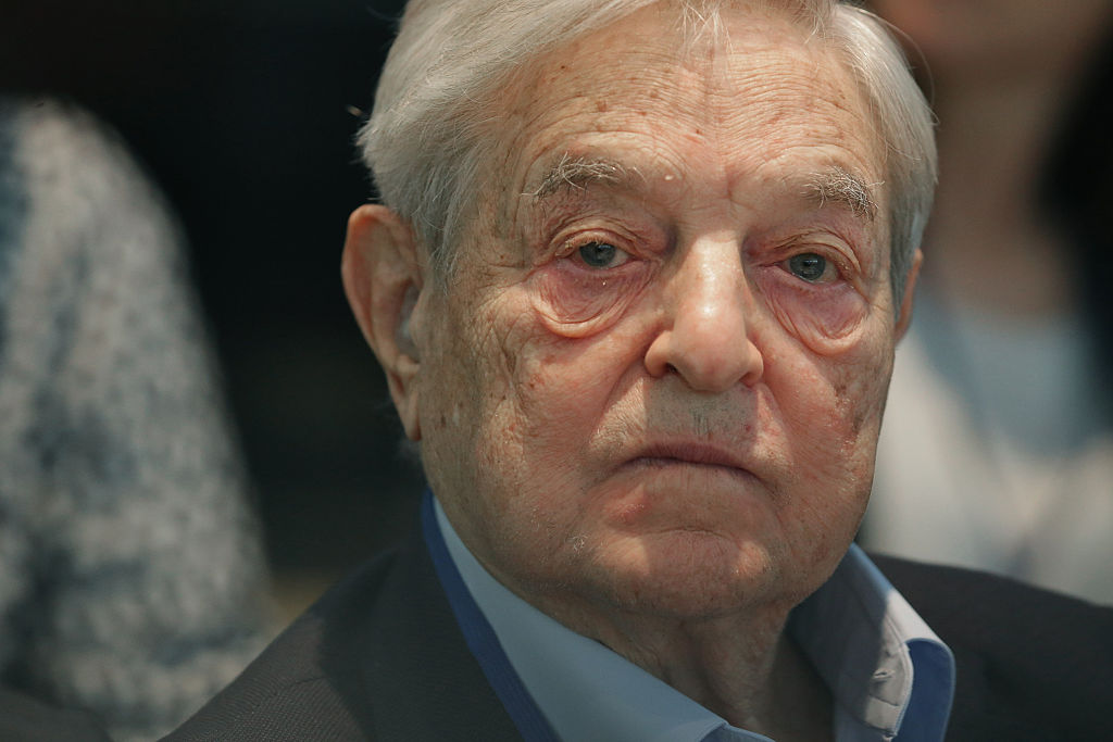 George Soros attends a meeting with finance and development ministers, international partners and the presidents of Liberia, Sierra Leone and Guinea (Getty Images)