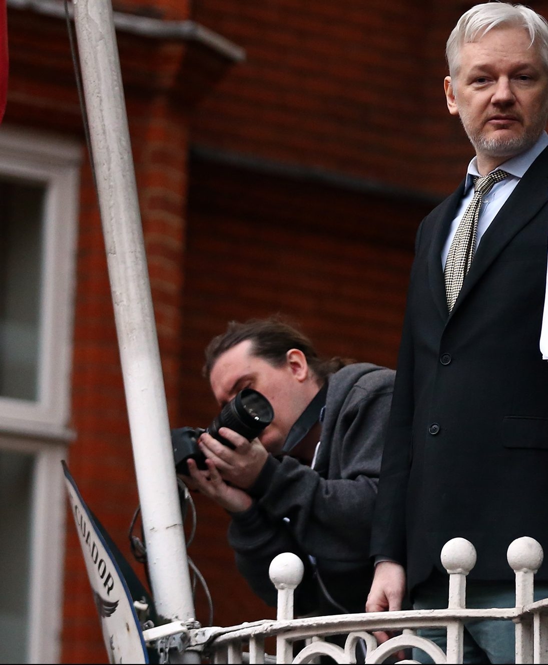 Julian Assange speaks from the balcony of the Ecuadorian embassy where he continues to seek asylum following an extradition request from Sweden in 2012 (Getty Images)