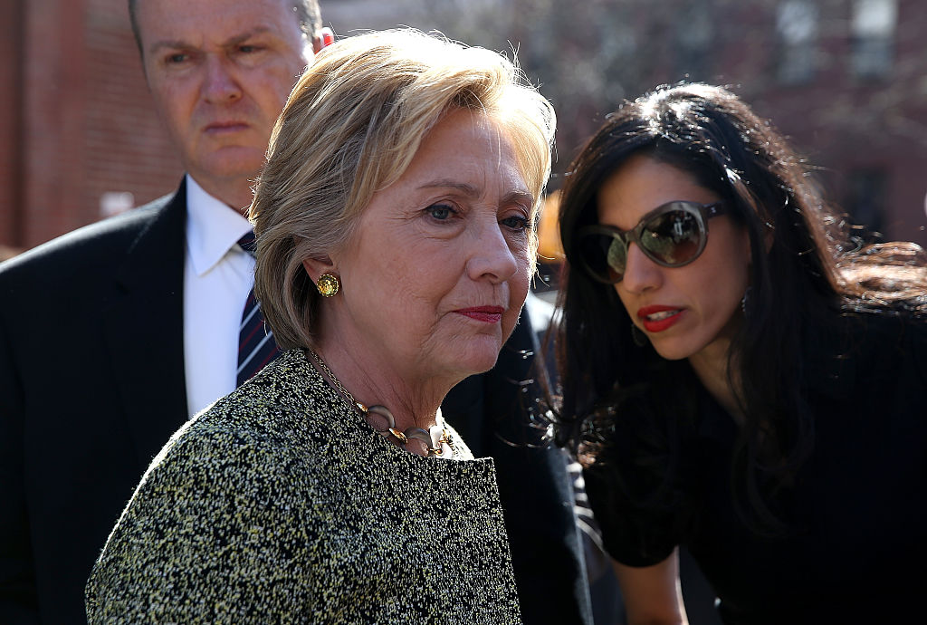 Hillary Clinton talks with aide Huma Abedin before speaking at a neighborhood block party on April 17, 2016 in Brooklyn (Getty Images)