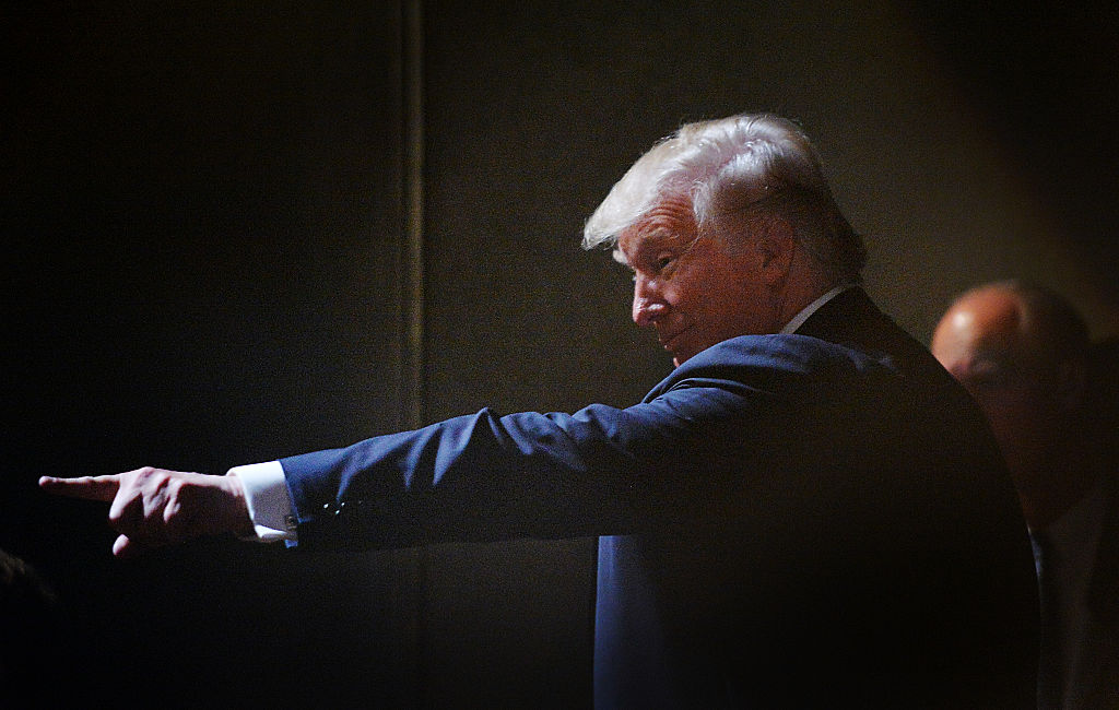 Donald Trump motions to the crowd while leaving the stage after a campaign event at the Duke Energy Center in Raleigh, North Carolina (Getty Images)