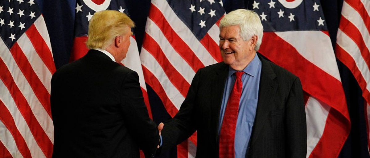 Former Speaker of the House Newt Gingrich shakes hands with Donald Trump during a rally at the Sharonville Convention Center July 6, 2016, in Cincinnati, Ohio