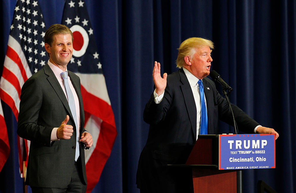 Donald Trump addresses the crowd as his son Eric Trump looks on during a campaign rally at the Sharonville Convention Center (Getty Images)