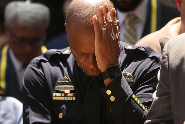 Dallas Police Chief David Brown pauses at a prayer vigil following the deaths of five police officers during a Black Live Matter march on July 8, 2016 (Getty Images)