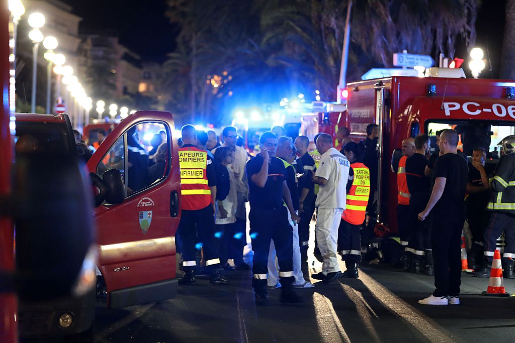 Police officers, firefighters and rescue workers are seen at the site of an attack on the Promenade des Anglais on July 15, 2016, after a truck drove into a crowd watching a fireworks display in the French Riviera town of Nice. (Getty Images)