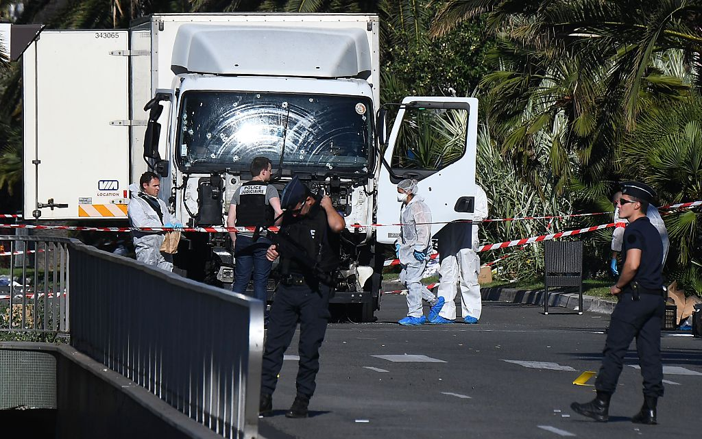 Forensics officers and policemen look for evidences in a truck on the Promenade des Anglais seafront in the French Riviera town of Nice (Getty Images)
