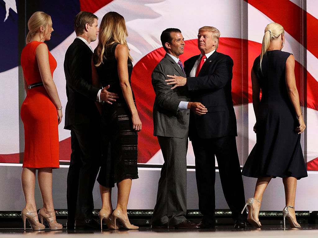 Donald Trump and his son Donald Trump Jr. embrace as Eric Trump, Lara Yunaska, Tiffany Trump and Vanessa Trump look on on the fourth day of the Republican National Convention (Getty Images)