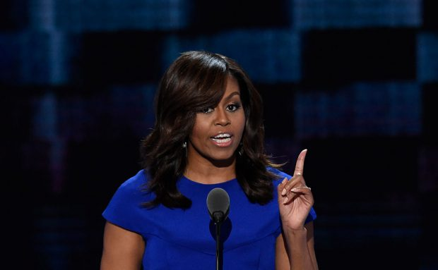 US First Lady Michelle Obama speaks during Day 1 of the Democratic National Convention at the Wells Fargo Center in Philadelphia, Pennsylvania, July 25, 2016. / AFP / SAUL LOEB (Photo credit should read SAUL LOEB/AFP/Getty Images)