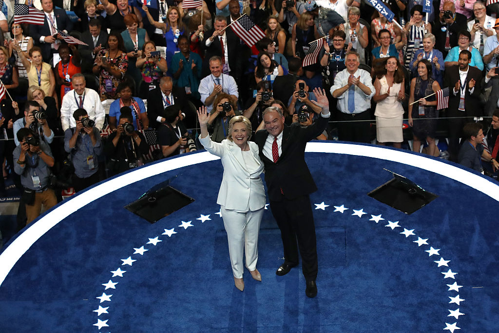 Hillary Clinton and Tim Kaine acknowledge the crowd at the end on the fourth day of the Democratic National Convention at the Wells Fargo Center, July 28, 2016 in Philadelphia, Pennsylvania. (Getty Images)