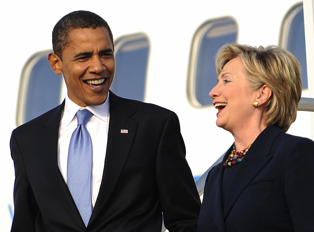 Barack Obama and Hillary Clinton disembark from Obama's campaign plane in Orlando, Florida (Getty Images)