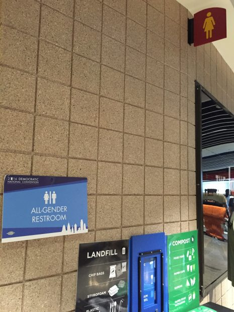 The special DNC all-gender restroom sign, juxtaposed against the regular women's restroom sign. [Blake Neff/Daily Caller News Foundation]