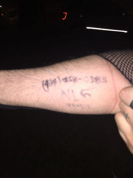 The contact info written on a protester's arm. [Blake Neff/Daily Caller News Foundation]