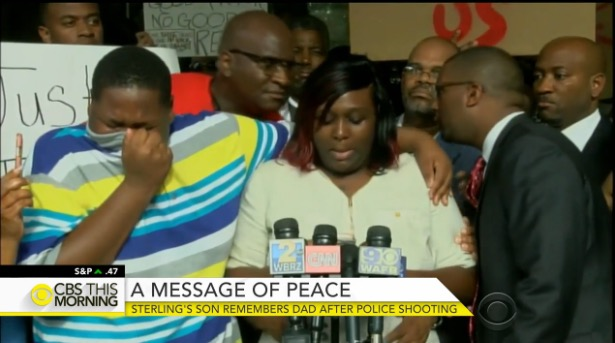 Alton Sterling's son, Cameron stands next to his mother at a press conference. (CBS)