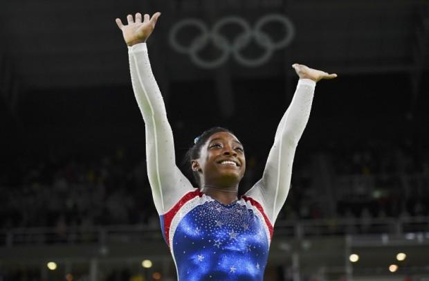 Simone Biles of USA celebrates winning gold in the women's gymnastics individual all-around final. REUTERS/Dylan Martinez
