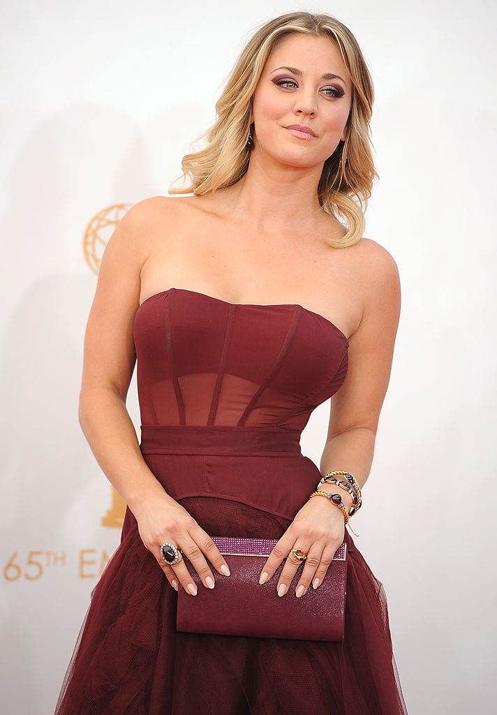 Cuoco poses for the camera on the red carpet for the 65th Emmy Awards (Photo credit should read ROBYN BECK/AFP/Getty Images)
