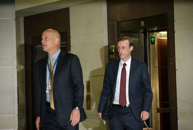 Jake Sullivan (R), Hillary Clinton's top foreign policy campaign adviser and her deputy chief of staff at the State Department, arrives for a closed-door deposition before the House Select Committee on Benghazi (Getty Images)