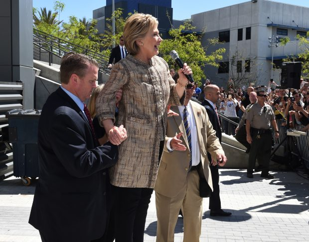US Democratic Presidential candidate Hillary Clinton speaks to the overflow crowd who were unable to get into the venue during a campaign rally at the Southwest College in Los Angeles, California on April 16, 2016. / AFP / Mark Ralston (Photo credit should read MARK RALSTON/AFP/Getty Images)