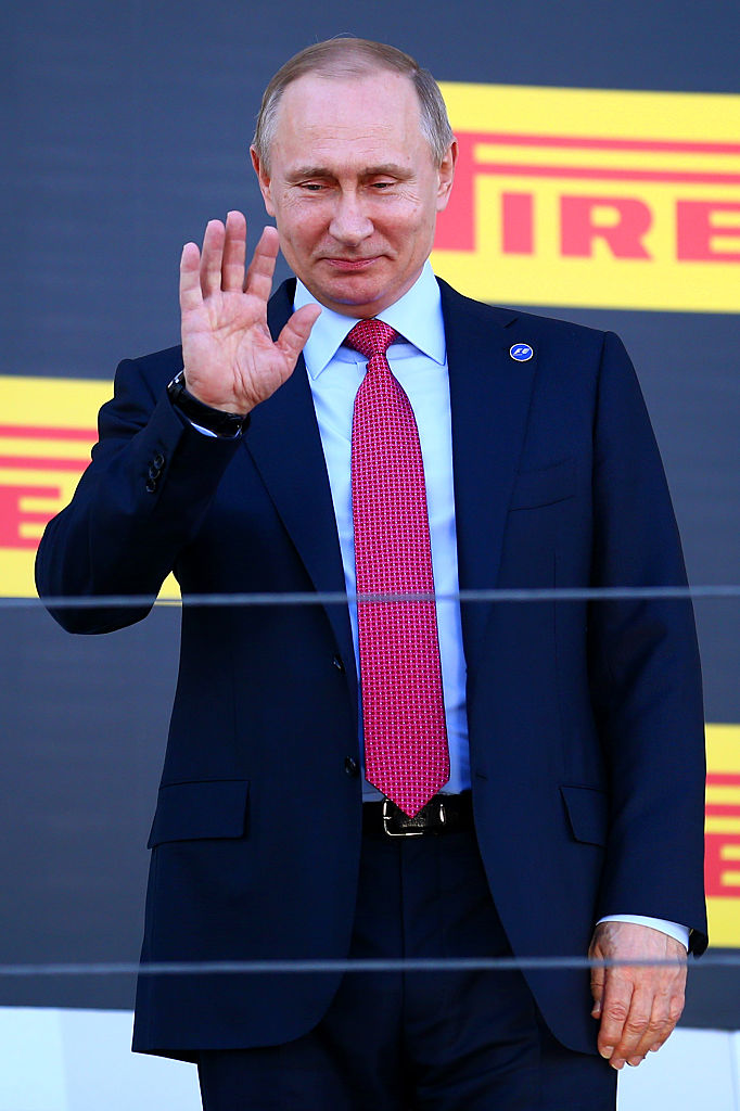 Russian President Vladimir Putin waves from the podium after the Formula One Grand Prix of Russia at Sochi Autodrom on May 1, 2016 (Getty Images)