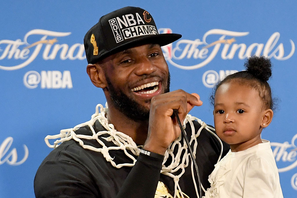 LeBron James holds his daughter Zhuri during a press conference after defeating the Golden State Warriors 93-89 in Game 7 of the 2016 NBA Finals (Getty Images)
